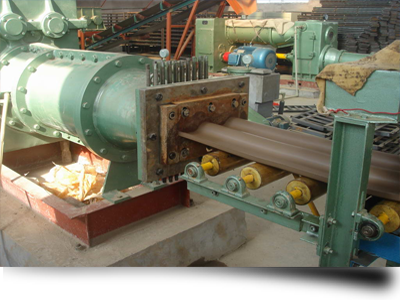 Machine for extruding clay roof tiles